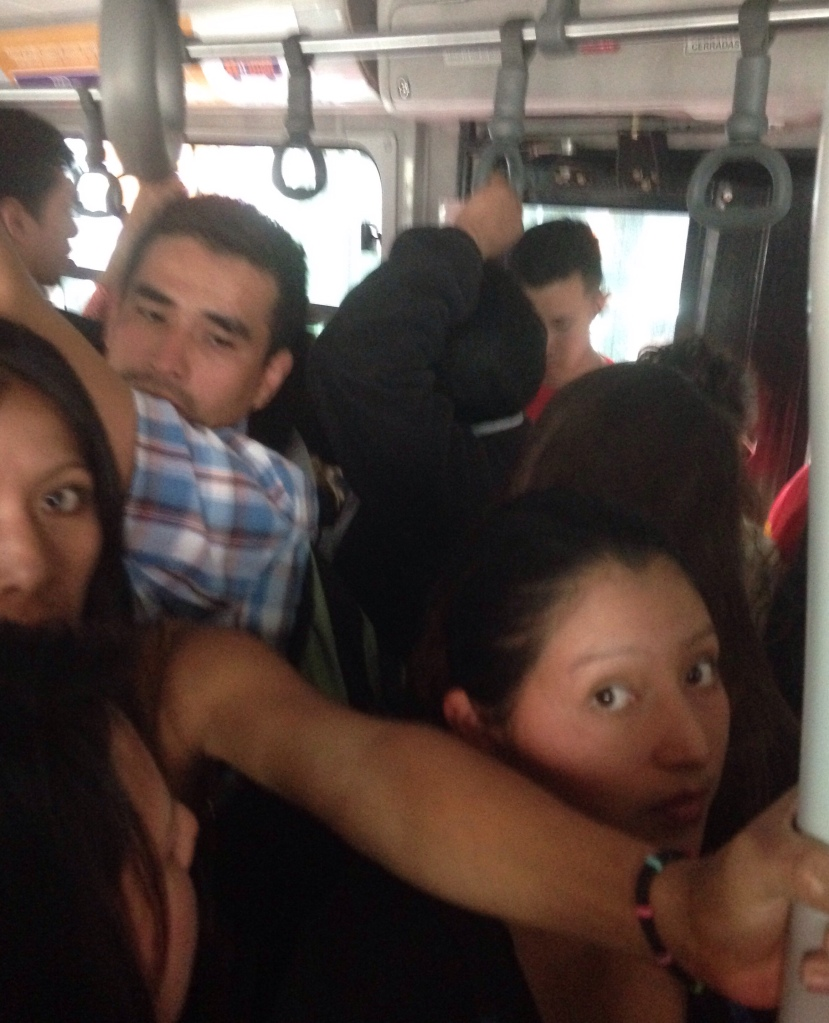 Packed bus from City Center to Quito Mariscal